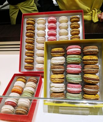 Colorful macarons displayed in gift boxes in Paris